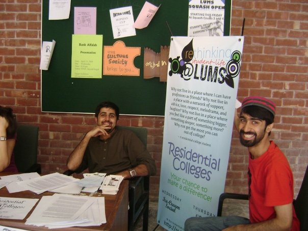 [Students at an information table about the proposed residential college system at LUMS]