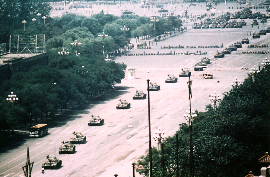 [The Tank Man near Tiananmen Square, 5 June 1989; photo by Stuart Franklin]