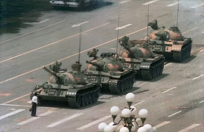 [The Tank Man near Tiananmen Square, 5 June 1989; photo by Jeff Widener]