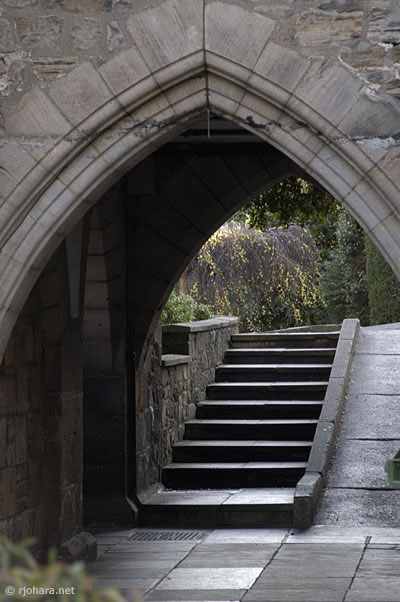 [Stone arch at the entrance to Dunham Court in Hatfield College, University of Durham]