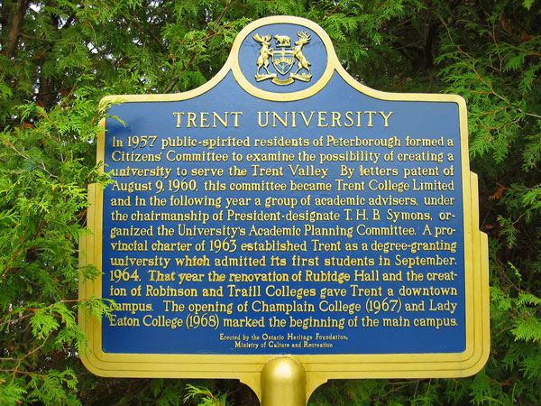 [Trent University entrance sign with the history of its first colleges]
